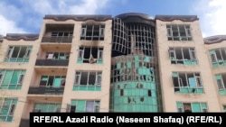 At least 32 civilians were killed by two gunmen who attacked a ceremony in Kabul marking the anniversary of the death of Shi'ite political leader Abdul Ali Mazari.