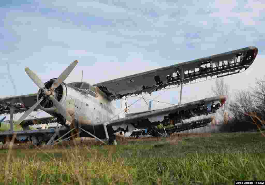 """A tattered Antonov An-2 in the base. A local pilot who once flew at the school saidhe watched as the airstrip, with its """"steel grandmas,"""" fell into disrepair. """"Day after day, we watched as everything died. It was terribly sad."""""""