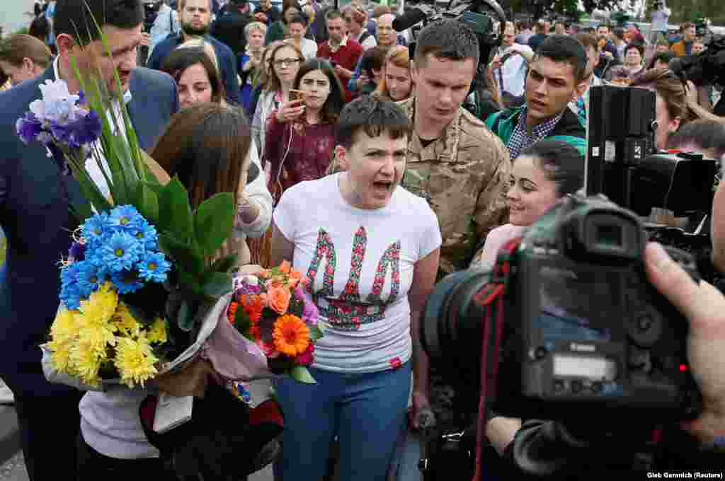 Ukrainian servicewoman Nadia Savchenko speaks to the media at Boryspil International Airport in Kyiv on May 25. Savchenko was captured in eastern Ukraine in June 2014 and transferred to Russia, where she was charged with aiding in the killing of two Russian journalists. She was released in a prisoner swap for two Russian detainees. (Reuters/Gleb Garanich)