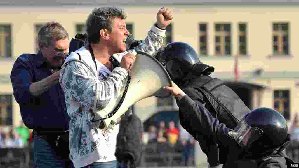 Police detain Nemtsov as he speaks at an opposition march in Moscow in 2011.