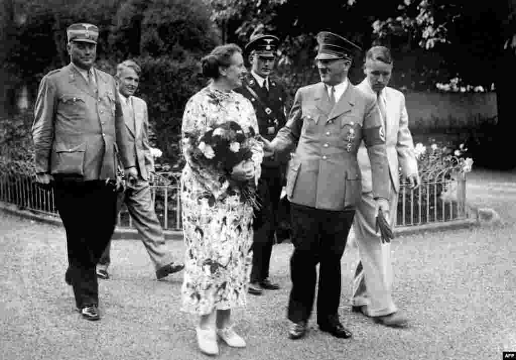 German Chancellor Adolf Hitler, a devotee of Wagner's music and writings, with the late composer's daughter-in-law, Winifred Wagner, and her two sons, Wolfgang and Wieland, in Bayreuth, Germany, in 1937