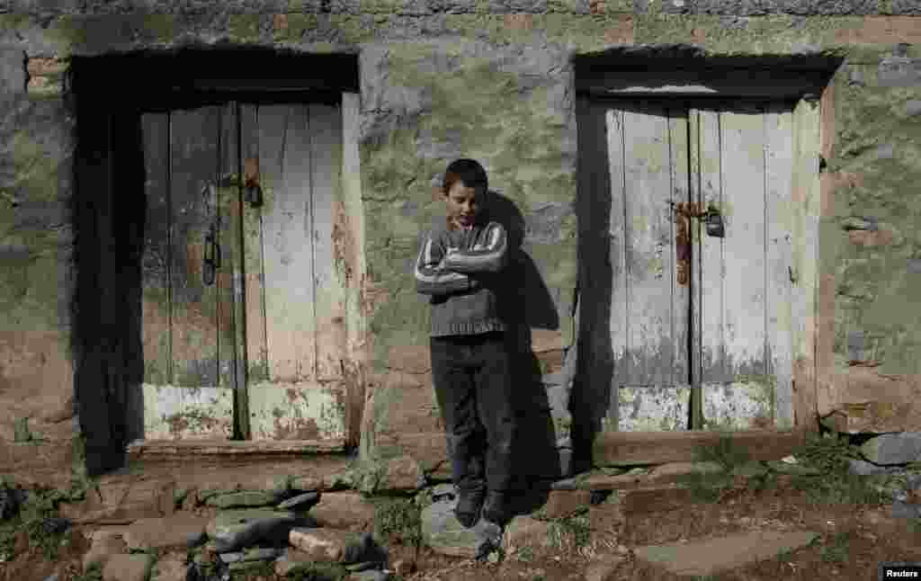 Nine-year-old Bacho Tsiklauri leans against a wall at his home in the village of Makarta, some 100 km north of Georgian capital Tbilisi.