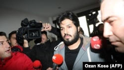 Detained Turkish-Iranian gold trader Reza Zarrab is surrounded by journalists in Istanbul in December 2013.