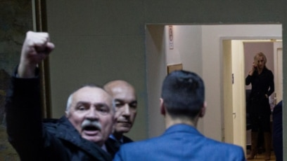 MONTENEGRO - Police officers escort opposition deputy Branko Radulovic from the Democratic Front, after they tried to prevent the vote on a bill on religious freedoms and legal rights of religious organizations in Montenegro's parliament in Podgorica, Mon