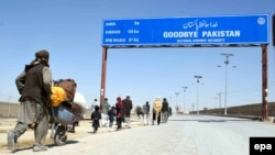 People cross into Afghanistan at the Pakistani-Afghan border in Chaman.