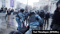 Riot police clash with football fans in central Moscow on December 11.