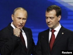 Russian President Dmitry Medvedev (right) and then Prime Minister Vladimir Putin at the United Russia party congress in Moscow in 2011.