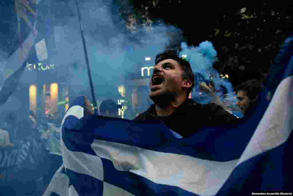 A protester in the Greek city of Thessaloniki shouts slogans on June 24 during a demonstration against the agreement reached by Greece and Macedonia to resolve a dispute over the former Yugoslav republic's name. (Reuters/Alexandros Avramadis)