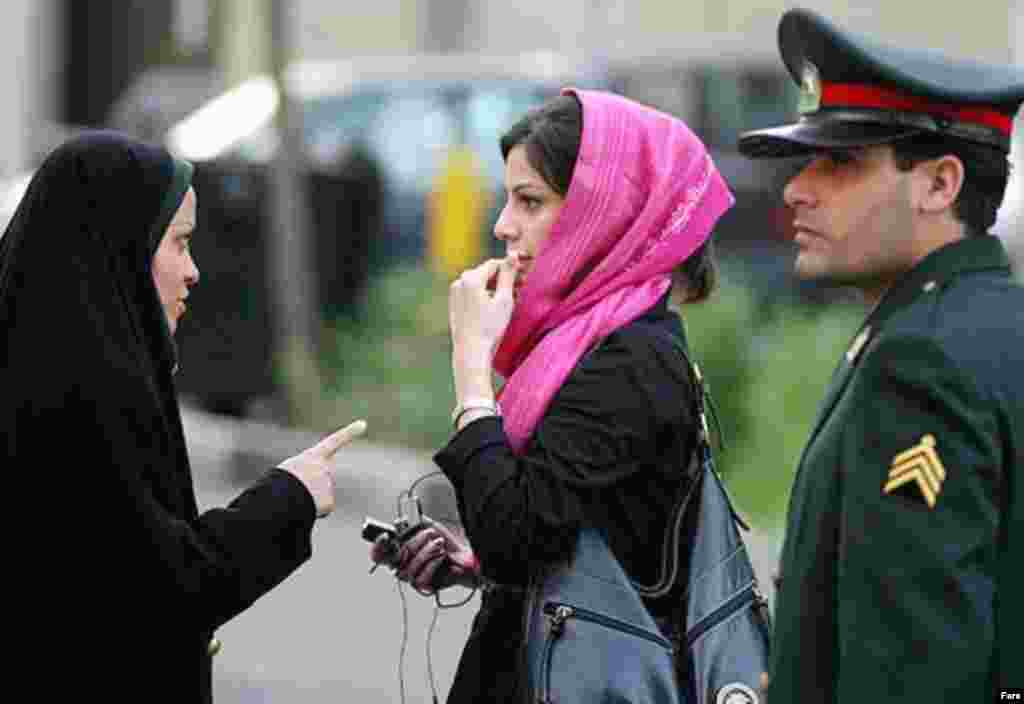 Police and Basij activists check women for proper dress in Tehran on April 22 (Fars) - April 27, 2007 (RFE/RL) -- Iranian police have launched a fresh crackdown on women caught violating strict Islamic dress-code rules. Such crackdowns on women wearing loose head scarves, tight or short coats, short pants, or make-up have become a routine part of Iranian life as summer approaches.