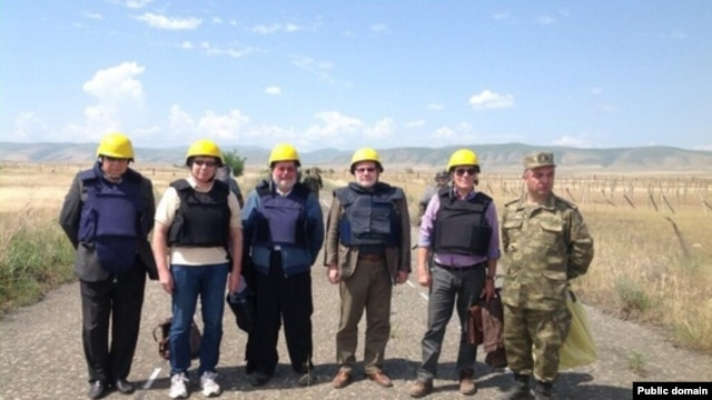 "Nagorno-Karabakh/Azerbaijan - The co-chairs of the OSCE Minsk Group pose for a photograph as they cross the Armenian-Azerbaijani ""line of contact,"" 19May2014."