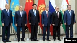 Given China's burgeoning presence in Uzbekistan, Uzbek President Islam Karimov (first from left) and his Chinese counterpart Xi JInping (third from left) probably had plenty to talk about on the sidelines of this week's Shanghai Cooperation Organization summit of regional leaders.