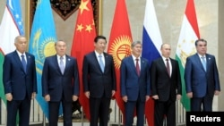 Participants of a Shanghai Cooperation Organization (SCO) summit pose for a photo in Bishkek, September 13, 2013