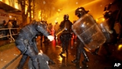 Riot police beat opposition activists at an antipresidential rally in front of the parliament building in Tbilisi on May 26.