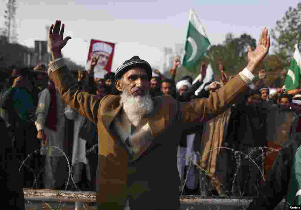 A supporter takes part in a rally in Islambad before the main group of marchers arrives.