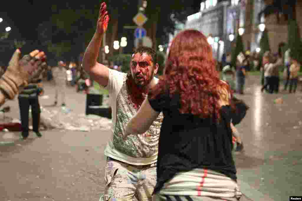 A man bleeding heavily in the early hours of June 21. Battles between police and security personnel continued through the night.