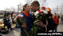 Dzmitry Bandarenka is welcomed from jail by wife Volha in Minsk on April 15.