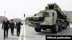Azerbaijan - President Ilham Aliyev (L) inspects a Russian-made Smerch multiple-launch rocket system deployed in Nakhichevan, 7Apr2014.