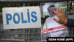 Turkey -- A protestor holds a picture of missing journalist Jamal Khashoggi during a demonstration in front of the Saudi Arabian consulate, on October 5, 2018 in Istanbul. Jamal Khashoggi.