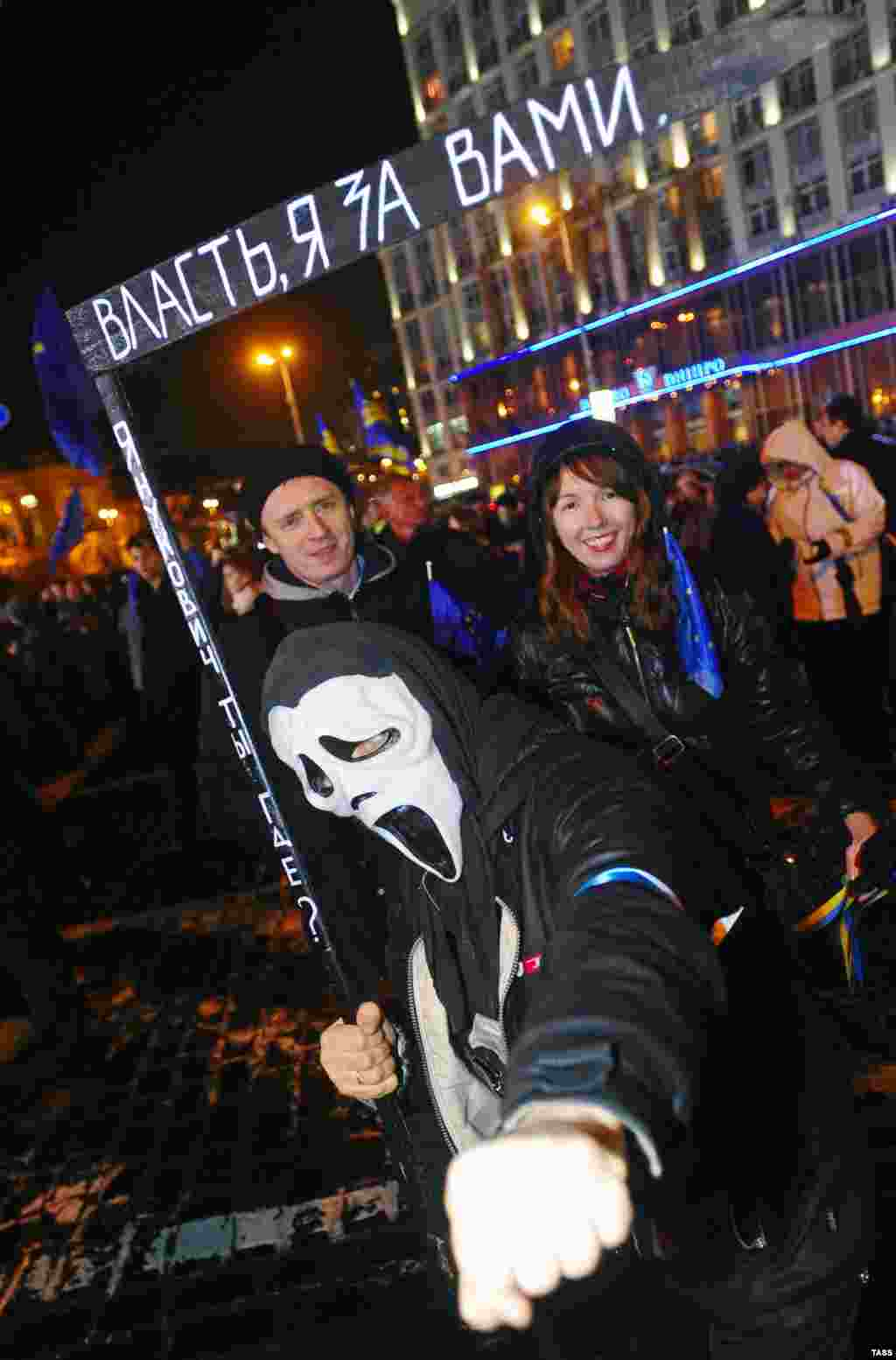 "The slogans on the scythe read: ""Yanukovych, where are you?"" and ""Government, I'm coming for you."""