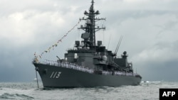The Japanese destroyer Takanami has departed for the Gulf of Oman to help protect shipping lanes, officials say.