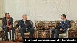 Сергей Аксенов (л) и Башар Асад (п)