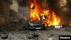 A car burns at the site of the deadly explosion in Beirut on October 19 that killed eight people.