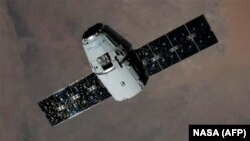 The first test flight of a SpaceX Dragon capsule has been scheduled for April. (file photo)
