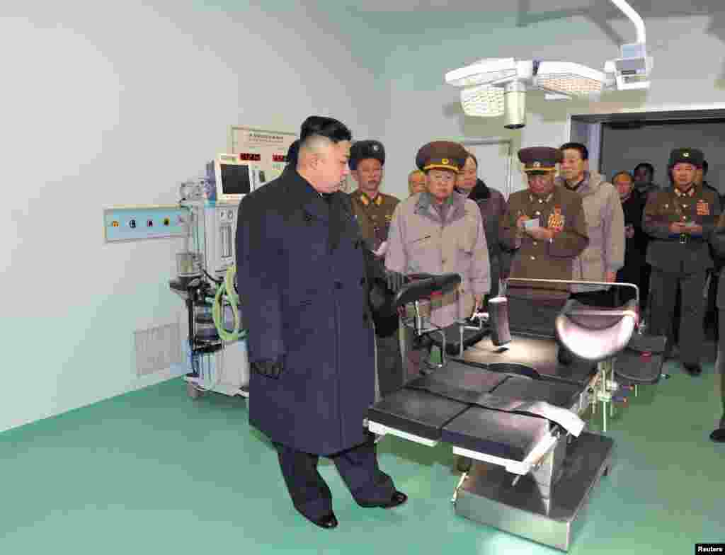 North Korean leader Kim Jong Un (front) visits the Taesongsan General Hospital being built by the People's Army in Pyongyang in this picture released by North Korea's KCNA news agency. KCNA said the hospital covers a total plot of more than 100,000 square meters and has three sick wards. (Reuters/KCNA)