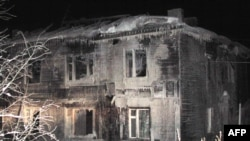 Росія - залишки згорівшого будинку для престарілих у селі Подєльск, Республіка Комі, 1 лютого 2009 р.