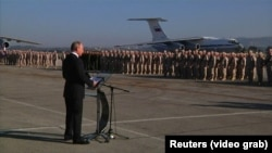 Russian President Vladimir Putin orders a partial troop withdrawal from Syria during a surprise visit to Russia's Hmeimim air base in Syria's Latakia Province on December 11.