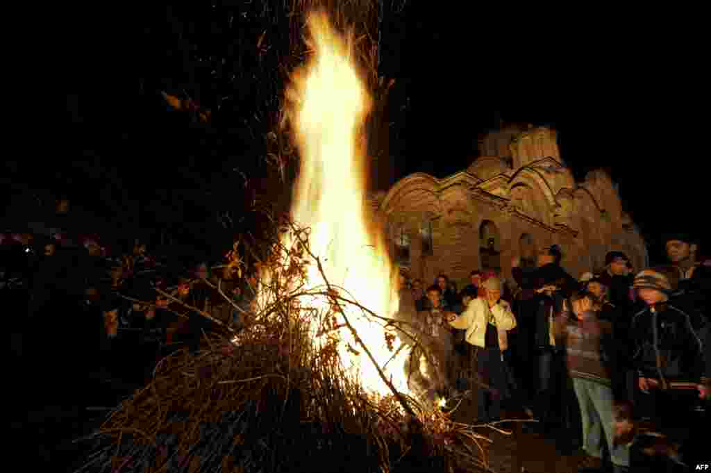 In Kosovo, ethnic Serbs gather around a bonfire at the medieval monastery of Gracanica on the eve of Orthodox Christmas, January 6, 2014