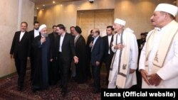 Iranian president Hassan Rouhani greeting Zoroastrian Mobads (clergy), just before his inauguration in Parliament on August 5, 2017.