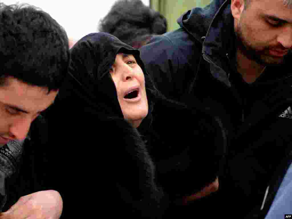Dodo Kharazishvili, the mother of late Georgian Olympian Nodar Kumaritashvili, mourns as his body is brought home. - Kumaritashvili was killed in a crash during a luge training run in Vancouver just before the start of the Olympics. The cause of the accident is under investigation. Photo by AFP