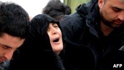 Dodo Kharazishvili, the mother of Nodar Kumaritashvili, mourns during his wake today in Bakuriani.