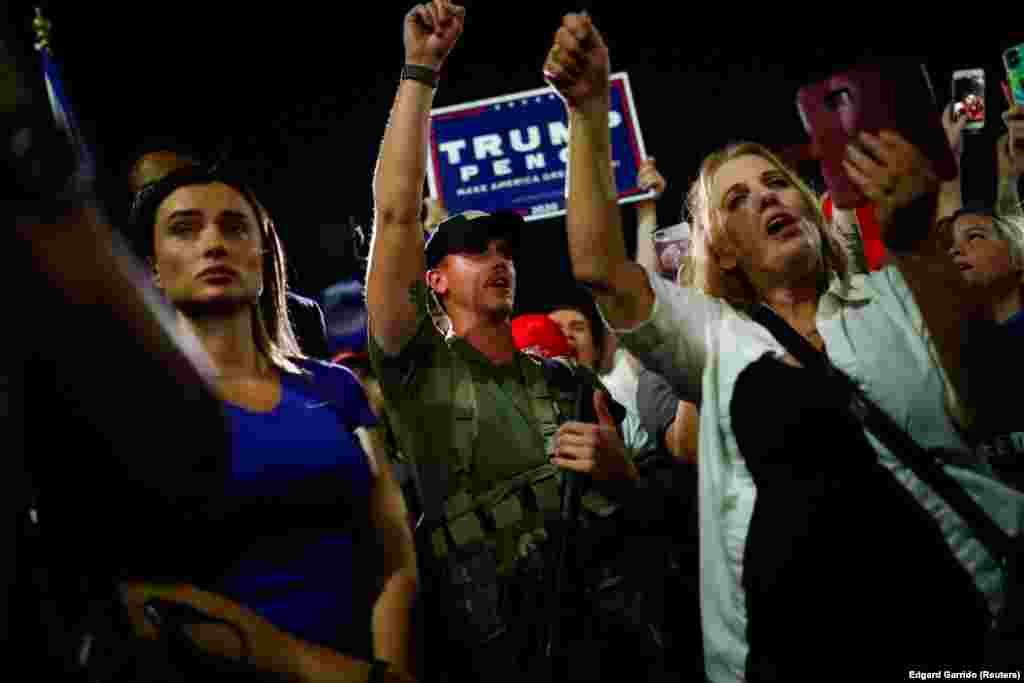Supporters of U.S. President Donald Trump gather in front of the Maricopa County Tabulation and Election Center (MCTEC) to protest about the early results of the 2020 presidential election, in Phoenix, Arizona, November 4, 2020.
