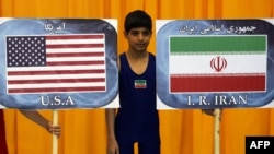 May 19: The U.S. and Iranian wrestling teams face in an exhibition match in Los Angeles.