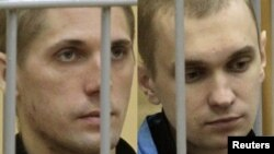 A combo photo of Uladzislau Kavalyou (left) and Dzmitry Kanavalau during a court hearing in Minsk in September 2011.