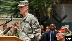 General Stanley McChrystal addressing NATO troops and dignitaries in Kabul in June