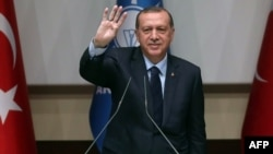 Turkish President Recep Tayyip Erdogan delivers a speech at the headquarters of the ruling AKP in Ankara on May 2.
