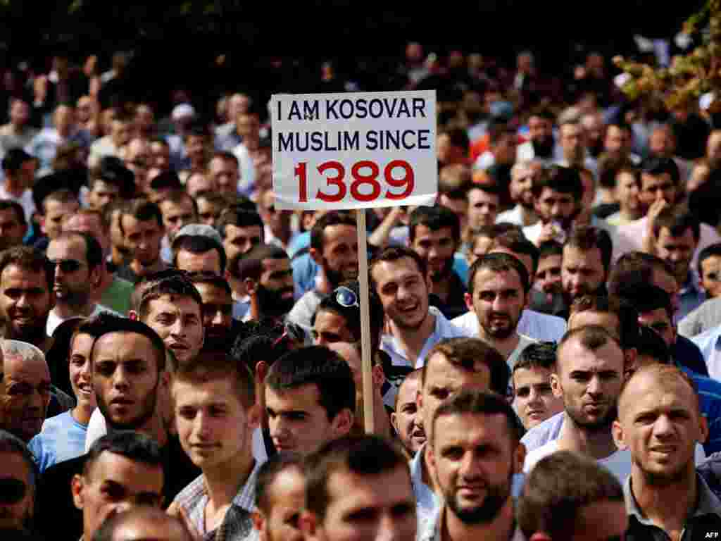Kosovar Muslims protest after Friday Prayers against a government decision to ban religious symbols, including Muslim head scarves in public schools, and demanding a space to build a new mosque in Pristina. (Photo by Armend Nimani for AFP)