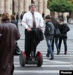 Armenia - Steve Wozniak, co-founder of Apple Inc., rides a segway in dowontown Yerevan, 10Nov2011.