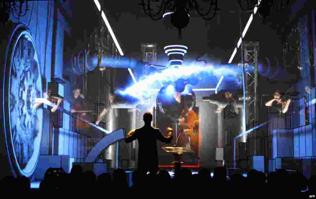 A man performs on stage during the official opening ceremony for activated energy links in Vilnius, by way of which Lithuania introduced new power lines to Sweden and Poland connecting the EU-member Baltic states to the Western energy market while reducing their dependence on imports from Russia. (AFP/Petras Malukas)