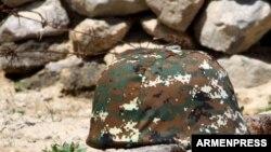 Armenia -- A military helmet, undated