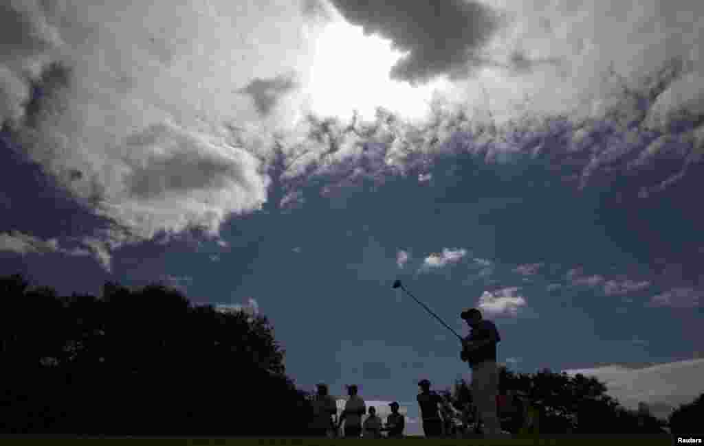 Adilson Da Silva of Brazil watches his tee shot during the first round of the men's golf compeititon.