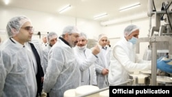 Armenia -- Prime Minister Nikol Pashinian (second from left) visits a new cheese factory opened by the Spayka company in Yerevan, March 26, 2019.
