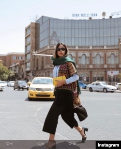 Young woman, downtown Tehran (Hasan Abad sqaure). From Instagram page.