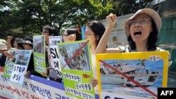 Атом кораллануга каршы Көньяк Кореяда узган протест чарасы