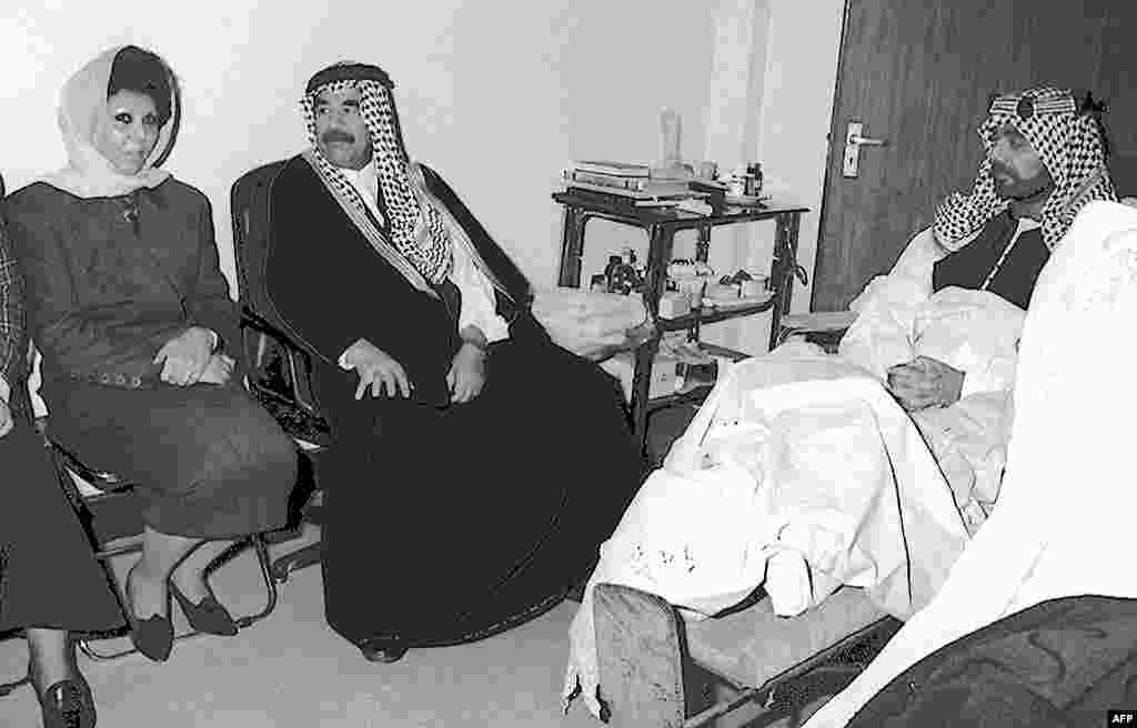 Saddam Hussein and his wife, Sajida, visit their son, Uday, after a failed assassination attempt on him in 1996. Uday was shot eight times which left him partially handicapped. Along with his brother, Qusay, he played a brutal role in the regime before being killed by U.S.-led forces in 2003.