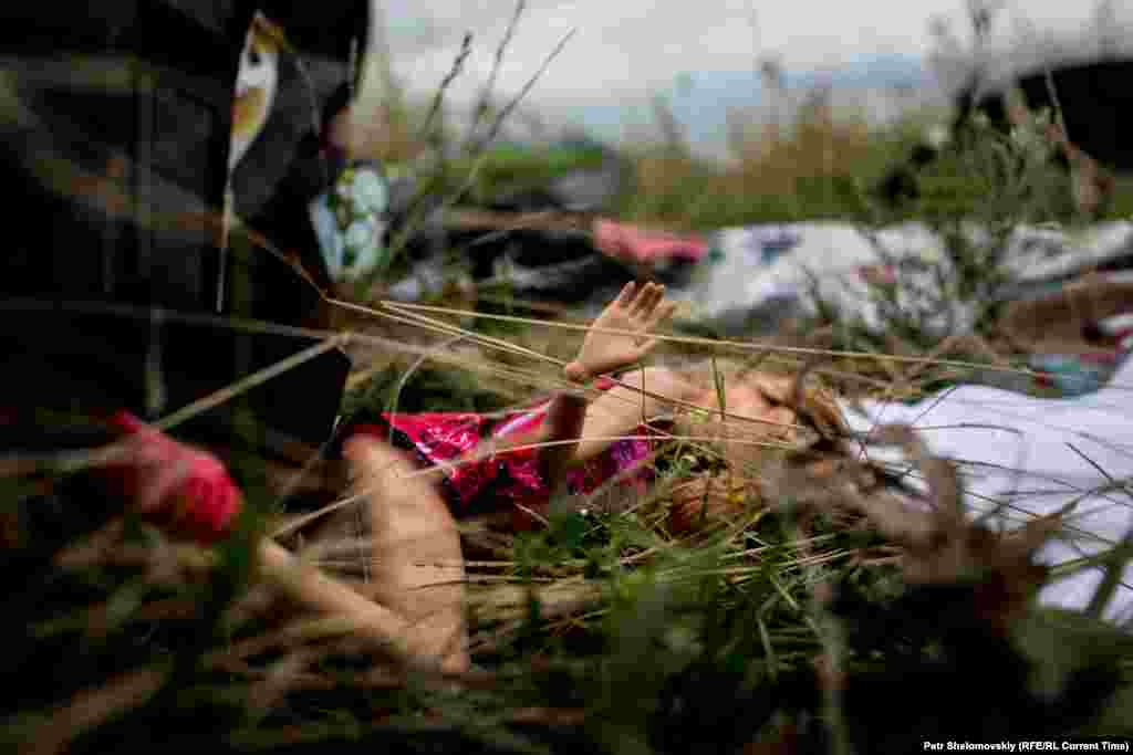 A child's doll is seen among the victims' belongings scattered near the village of Grabovo.