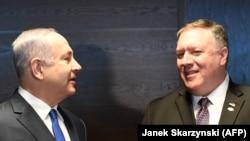 Pemierul israelian Benjamin Netanyahu și secretarul de stat american Mike Pompeo, Varșovia, 14 februarie 2019